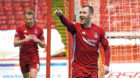 Aberdeen's Niall McGinn hopes to be celebrating against Celtic tomorrow.