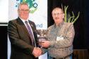 NFU Scotland president Andrew McCornick presents the union's David Miskelly award to Sutherland crofter Sandy Murray