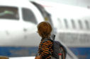 A young boy looks at an aircraft at Aberdeen Airport.