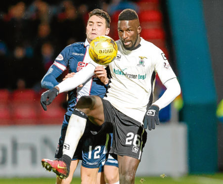 Tim Chow in action for Ross County against Caley Thistle's Lonsana Doumbouya in December 2016.