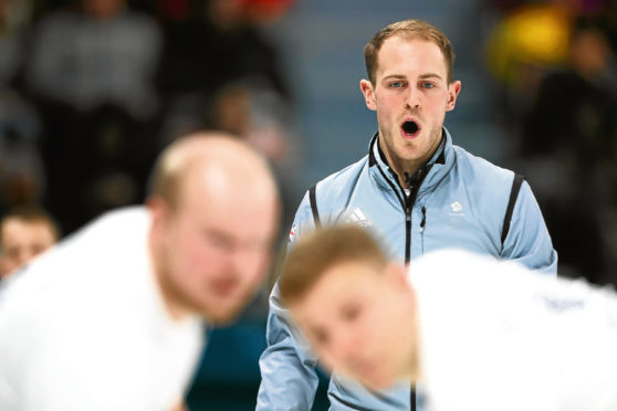 GANGNEUNG, SOUTH KOREA - FEBRUARY 14:  Kyle Smith of Great Britain compete in the Curling Men's Round Robin Session 1 held at Gangneung Curling Centre on February 14, 2018 in Gangneung, South Korea.  (Photo by Dean Mouhtaropoulos/Getty Images)