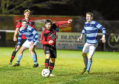 Morrison Motors (Turriff) Aberdeenshire Shield - Round 2 Inverurie Loco Works (red) v Banks o' Dee FC (white/blue) at Harlaw Park. Picture of Neil Gauld with the ball.  Picture by Jason Hedges     10/01/2018