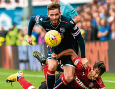 Ross County defender Jason Naismith joins Peterborough United on three-year deal
