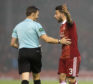 Aberdeen's Graeme Shinnie (right) with referee Steven McLean