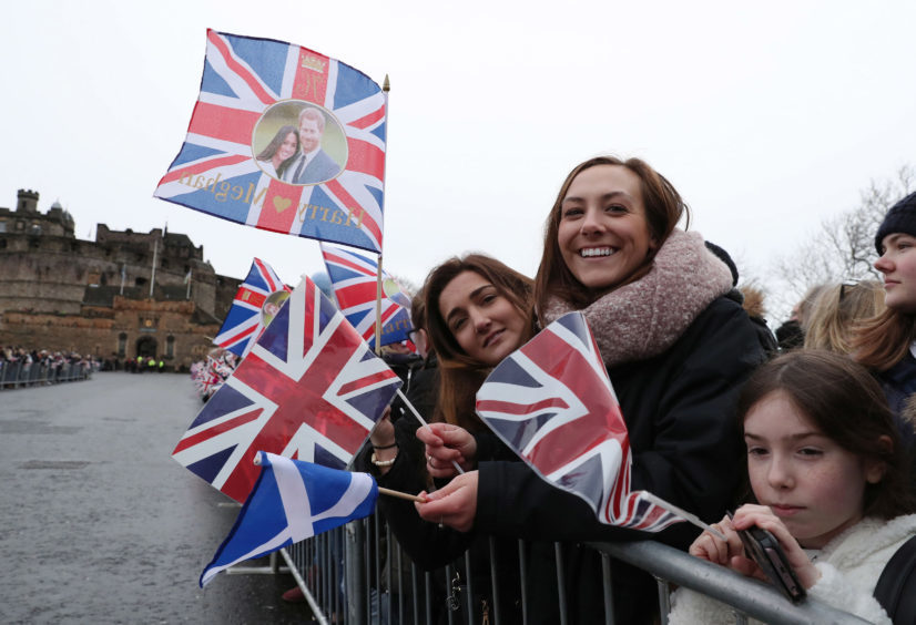 Crowds gather ahead of a visit by Prince Harry and Meghan Markle to Edinburgh Castle