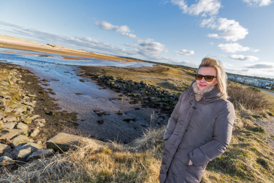 Linda Laing got stuck in mud on the banks of the River Lossie.