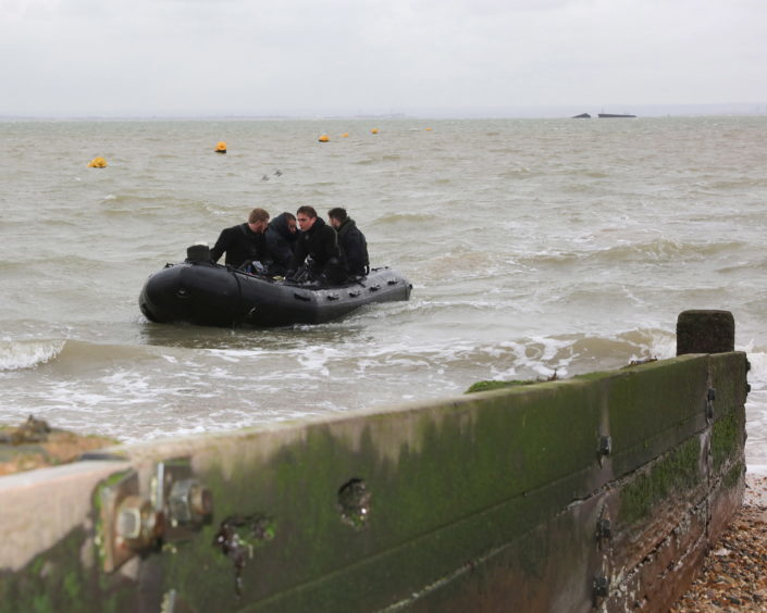 Divers return to the shore after sucessfully destroying the UXO