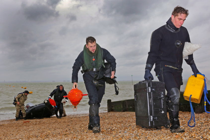 R-L Able Seaman Diver Alessandro Bonato and Leading Diver Tom Parker return after sucessfully destroying the UXO