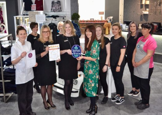 Jo Robinson, VisitScotland Regional Director is pictured presenting a 5 Star plaque and Taste Our Best certificate to owners of The Platform and Annie's Cakery, Elaine Williams and Annie Anderson, who are joined by their staff.