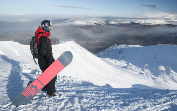 Snowboarder Rhys Crilley from Glasgow, peering into the Back Corries at Nevis Range, Scotland. Picture: Steven McKenna Photography