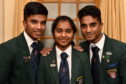 Picture of 16 year old triplets (L-R) Alwin, Anley, Alen James from Hazlehead Academy with Silver Certificates.