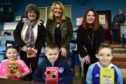Launching the new reading initiative for children at Balmoor Stadium were  Cllr Gillian Owen, Cllr Dianne Beagrie and Jill Strachan. From Peterhead Library Emily Campbell, Cameron Beddie and Arran Thomson.