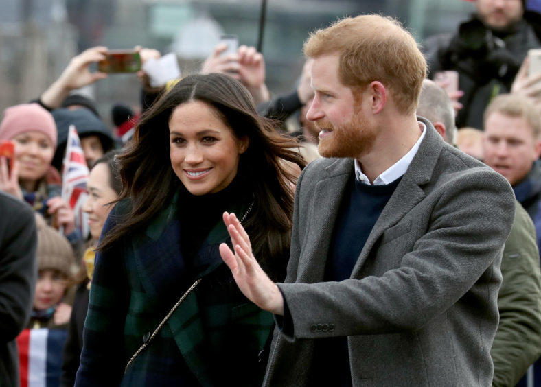 Prince Harry and Meghan Markle during a walkabout on the esplanade at Edinburgh Castle