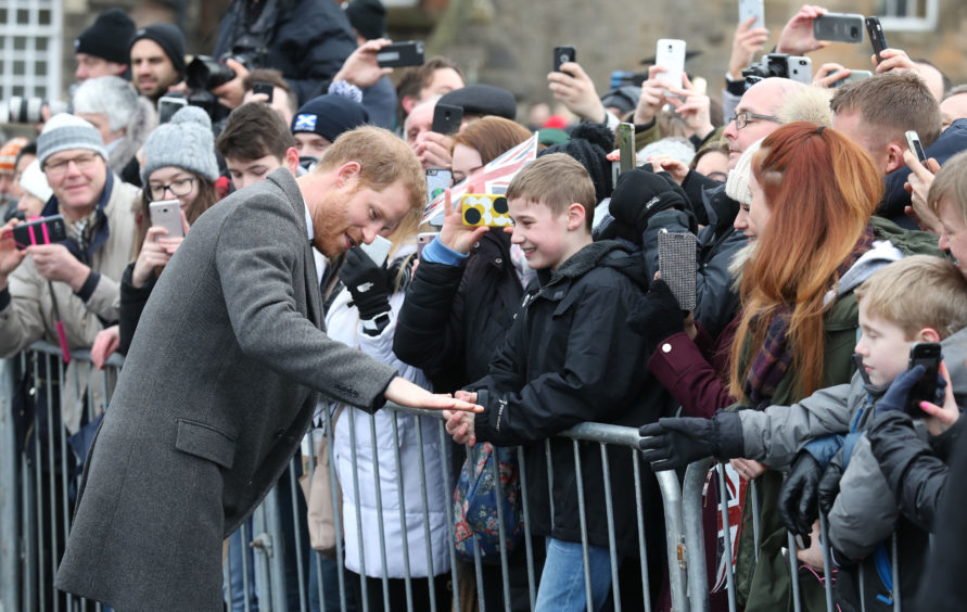 Prince Harry during a walkabout on the esplanade at Edinburgh Castle