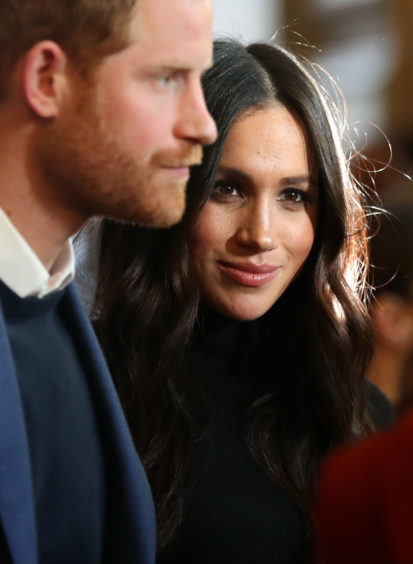 Prince Harry and Meghan Markle during a reception for young people at the Palace of Holyroodhouse, in Edinburgh, during their visit to Scotland