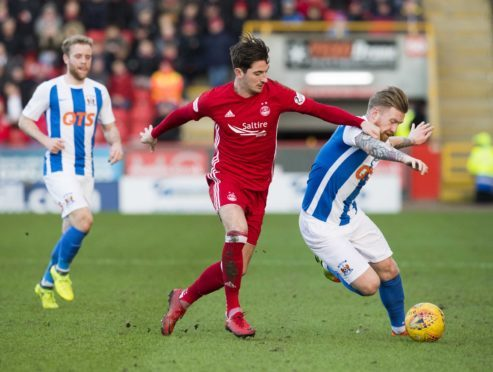 Kilmarnock's Rory Mackenzie and Aberdeen's Kenny McLean contest the ball at Pittodrie.