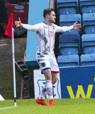 Ross County's Alex Schalk celebrates after making 3-1 against Dundee on Saturday.