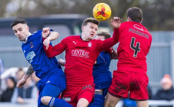 Falkirk's Paul Watson fights for possession with Cove Rangers' Scott Ross (L) and team mate Aaron Moorhead