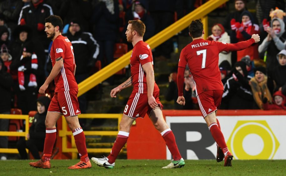 Aberdeen's Kenny McLean (R) celebrates his goal with team mates