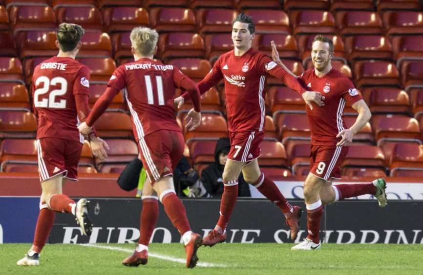 Aberdeen's Kenny McLean (7) celebrates his goal with Gary Mackay-Steven (11) Ryan Christie (22) and Adam Rooney (R)