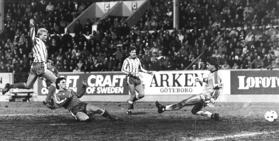John Hewitt puts the ball past the Gothenburg goalkeeper.