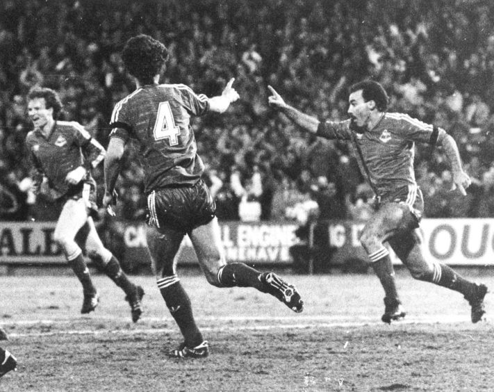 A delighted Willie Miller right) celebrates his opening goal for Aberdeen.
