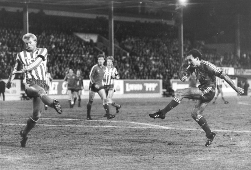 Dons Skipper Willie Miller crashes the ball into the Gothenburg net for the opening goal.