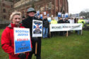 Michael Ross's parents Moira and Eddie Ross lead a silent vigil outside the St Magnus cathedral in Kirkwall.