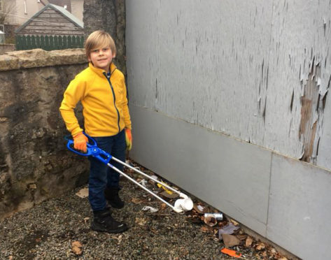 Thomas litter picking in Torphins