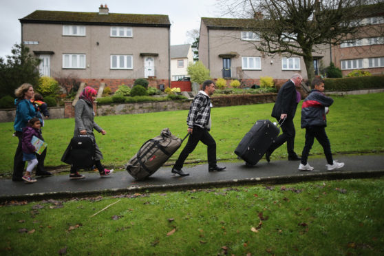 Syrian refugee families arrive at their new homes on the Isle of Bute.