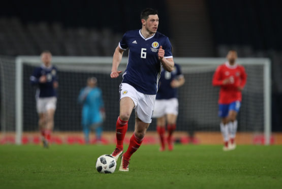 Scott McKenna was recalled to Scotland's starting line-up.