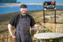 The Seafood Cafe owner Ian Mcghie with some of his dishes. Pictures by JASON HEDGES