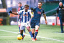 Kilmarnock's Aaron Tshibola (left) and Ross Draper in action.