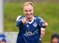 Jordon Brown celebrates scoring his side's third goal.