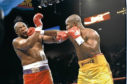 George Foreman (left) and Michael Moorer trade blows during a bout in Las Vegas, Nevada