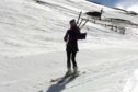 The footage shows the piper sking downhill whilst blowing a tune at the Glenshee Ski Centre.