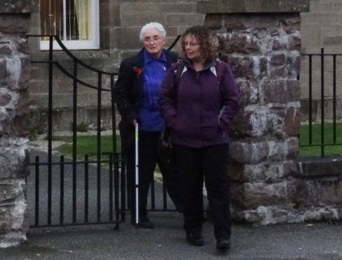 DAMAGE CLAIMS: Lewis crofter Kathleen Allen, at back left, has raised a civil action case against neighbours David and Janine Hargreaves.