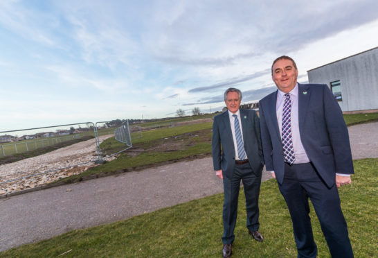 Cllr John Cowe and Cllr James Allan at the new Lossiemouth High School site