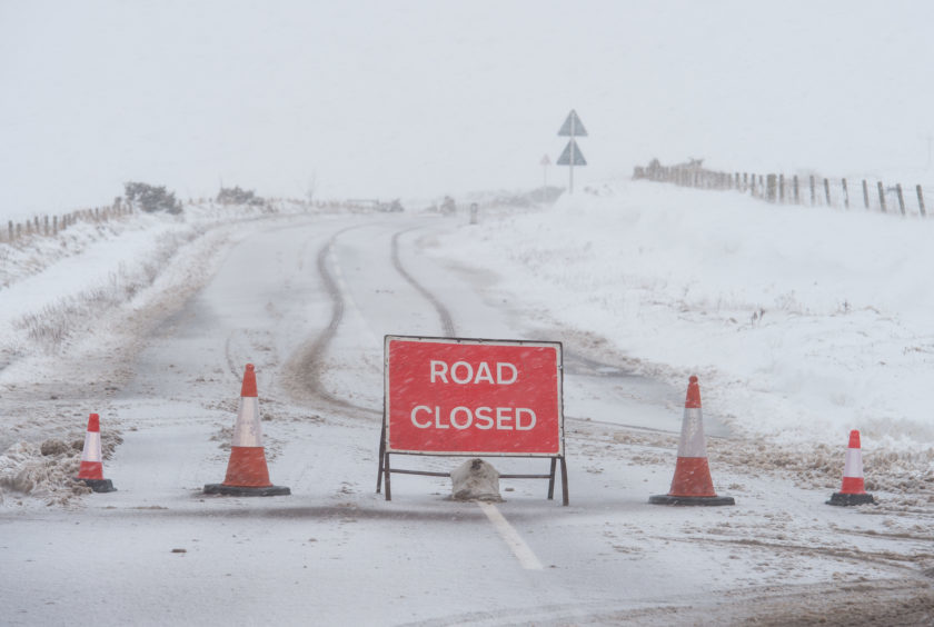 Pictures show the closed road signs up on the A942 Findochty to Portknockie road.