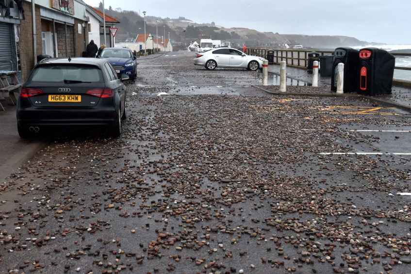 Stonehaven Promenade was flooded and now has been left with pebbles in the car park.