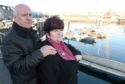 June and Hugh McLeod, parents of Kevin, close to where he was found in Wick Harbour 21 years ago.