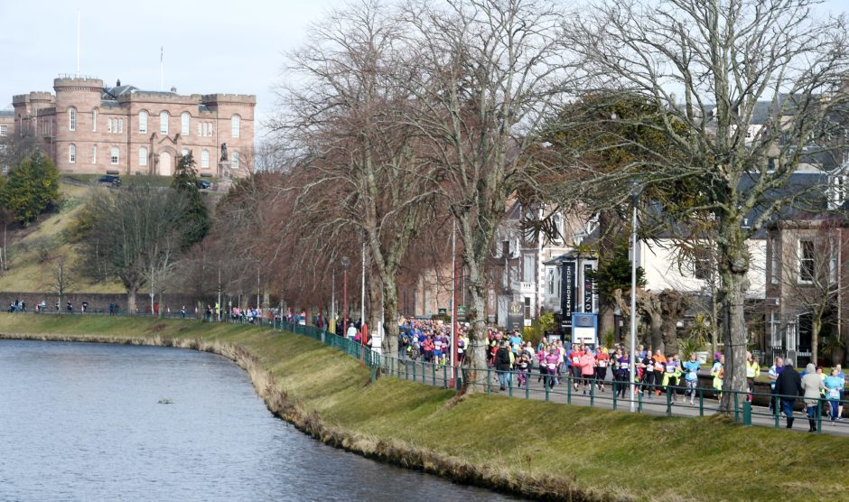 Runners in both races make their way past Inverness Castle.