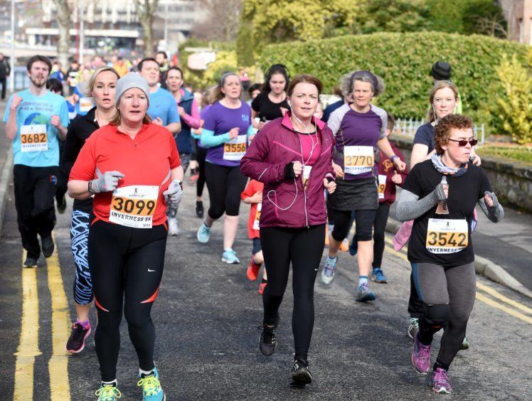 Runners on Ness Walk.