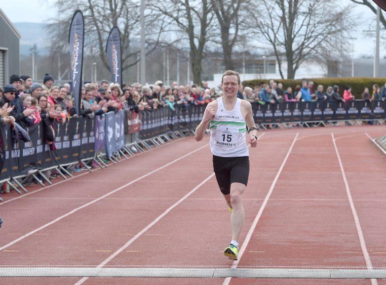 Runner up Kris Jones crosses the finishing line.