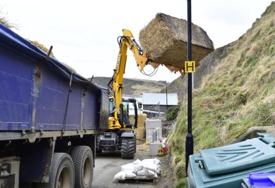 Work has started to clear the road at Gardenstown.