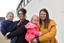 Banff Playgroup and Toddlers chairwoman Nicki Payne with son Lachlan, and Vice Chair Jillian McBain, with daughter Emmy