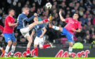 Scotland's Oliver McBurnie (left) and Costa Rica's David Guzman battle for the ball during the international friendly match at Hampden Park, Glasgow.