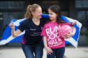 Scottish Thistles team captain Claire Brownie with nine-year-old Amy Reid. Photo by Mark Anderson.