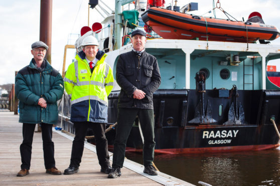 Gordon Law (left) and Stuart Craig of the Clyde River Steamer Club joined CalMac's small vessel technical superintendent, Jonathan Davies for a last look around the vessel.