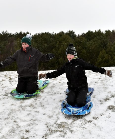 Westhill Golf Course was turned into a winter wonderland as sledges descended on the slopes. Fraser Sim (left) with pal Scott.